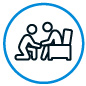 Icon of person helping another person in an armchair